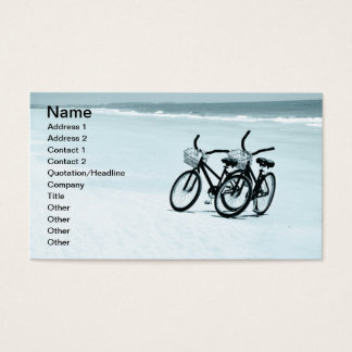 two empty touring bikes on a beach business card
