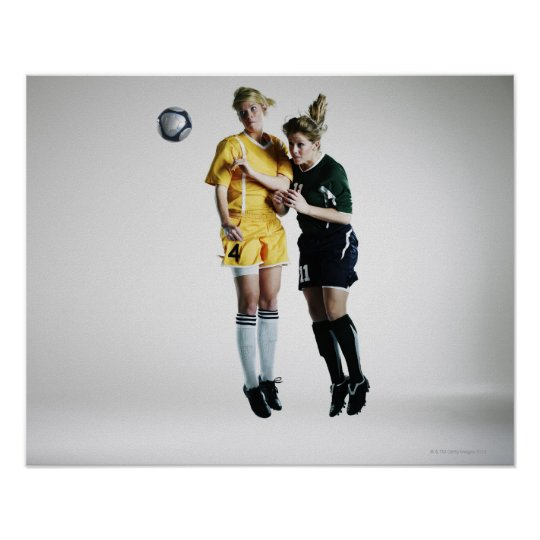 Two female soccer players in mid air heading poster