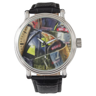 Two Fire Helmets And Fireman's Jacket Watch