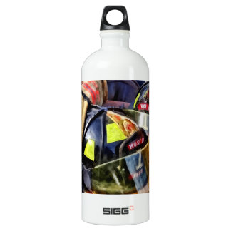 Two Fire Helmets And Fireman's Jacket Water Bottle