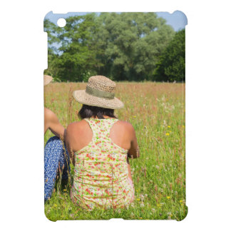 Two friends sitting together in meadow.JPG iPad Mini Cover