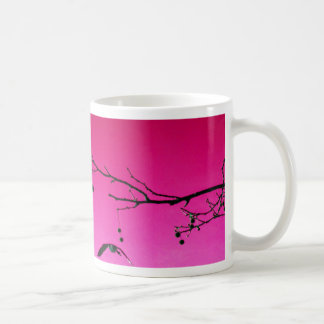 two geese flying in pink sky coffee mug