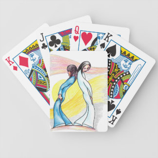 Two girls back to back bicycle playing cards