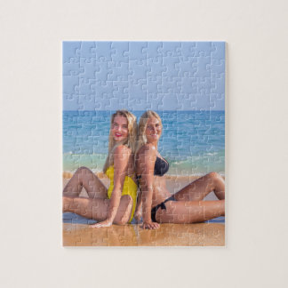 Two girls sit on beach near blue sea.JPG Jigsaw Puzzle