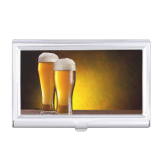 Two glasses of beers on a wooden table business card case