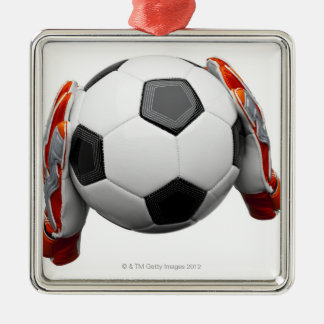 Two goal keepers gloves holding a football metal ornament