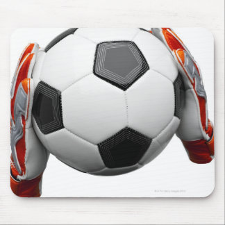 Two goal keepers gloves holding a football mouse pad