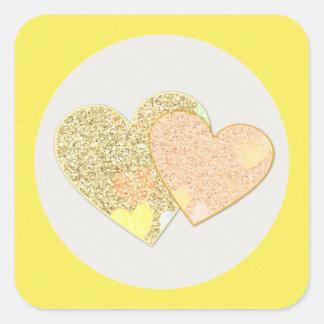 Two gold glitter hearts square sticker