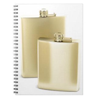 Two golden hip flasks notebooks
