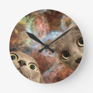 Two Gray Cats in Space Before a Nebula Round Clock