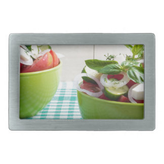 Two green bowl with vegetable vegetarian salad rectangular belt buckles