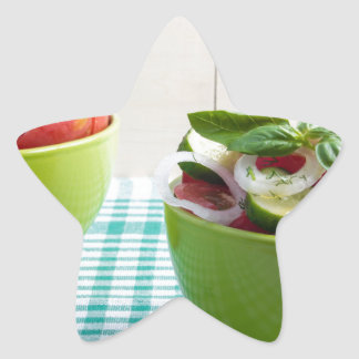 Two green bowl with vegetable vegetarian salad star sticker