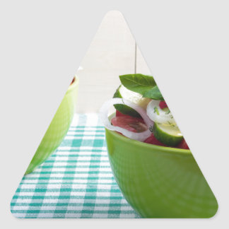 Two green bowl with vegetable vegetarian salad triangle sticker