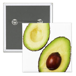 Two halves of an an avocado, on white 2 inch square button