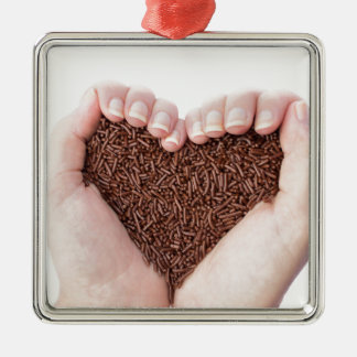 Two hands holding chocolate sprinkles Silver-Colored square ornament
