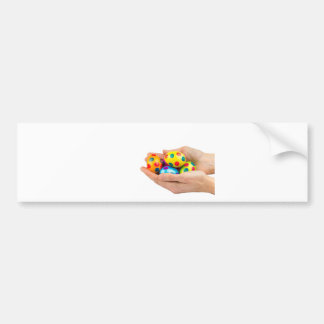 Two hands holding  painted easter eggs on white bumper sticker