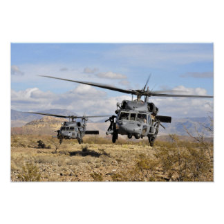 Two HH-60 Pavehawk helicopters preparing to lan Poster