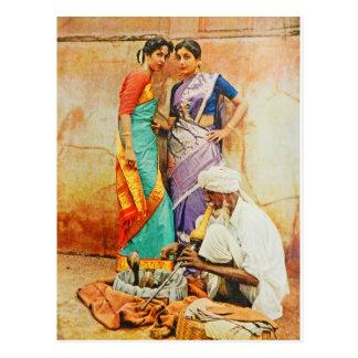 two hindu women with a snake handler postcard