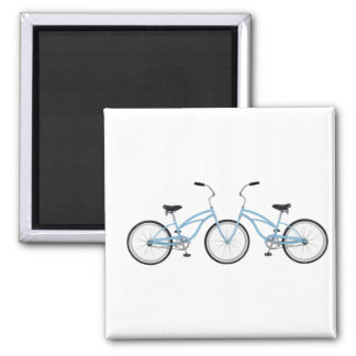 Two interlocking blue bicycles refrigerator magnets