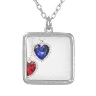 Two jewelry hearts blue and red hanging together
