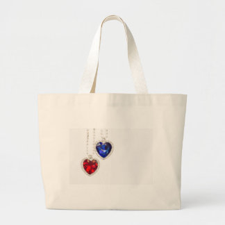 Two jewelry hearts blue and red hanging together large tote bag