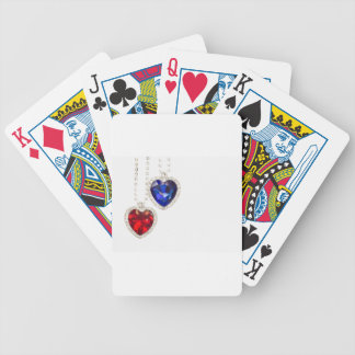 Two jewelry hearts blue and red hanging together poker deck
