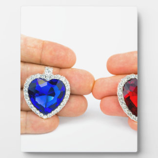 Two jewelry hearts on hand of man and woman plaque
