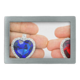 Two jewelry hearts on hand of man and woman rectangular belt buckles