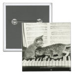 Two kitten playing on piano keyboard, (B&W) 2 Inch Square Button