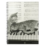 Two kitten playing on piano keyboard, (B&W) Notebook