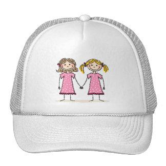 Two little girls holding hands trucker hat