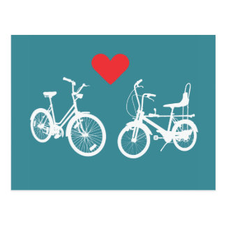 Two lovely vintage bikes find love postcard