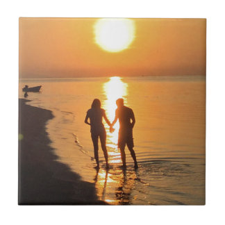 Two lovers at sunrise tile