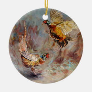 Two male ring-neck pheasants fighting. ceramic ornament