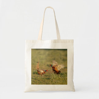 Two male ring-neck pheasants fighting. tote bag