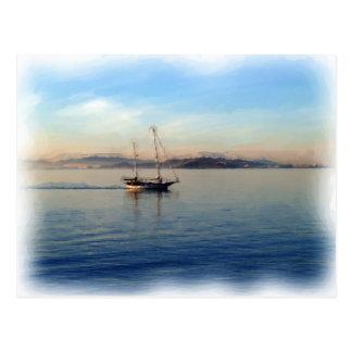 Two-masted sailboat motoring postcard