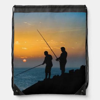 Two Men Fishing at Shore Drawstring Bag