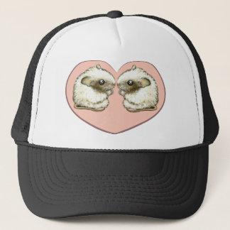 Two mice in a love heart trucker hat