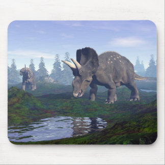 Two nedoceratops/diceratops dinosaurs walking mouse pad