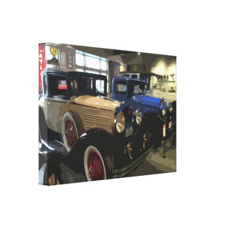 Two Old Classic Vintage Cars indoors on Display Canvas Print
