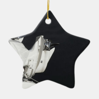 Two outboard boat motors ceramic star ornament