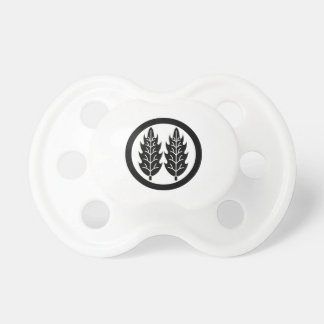 Two parallel holly leaves in circle pacifier