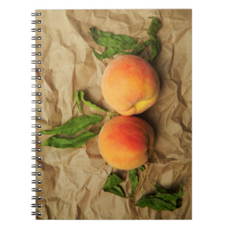 Two peaches. spiral notebook
