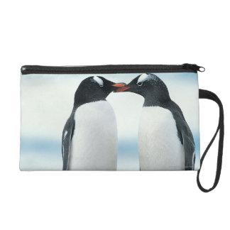Two Penguins touching beaks Wristlet Purses