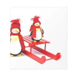 Two penguins with sleigh and christmas tree notepad