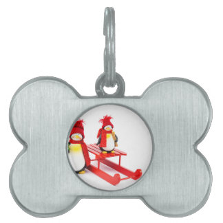 Two penguins with sleigh and christmas tree pet name tag