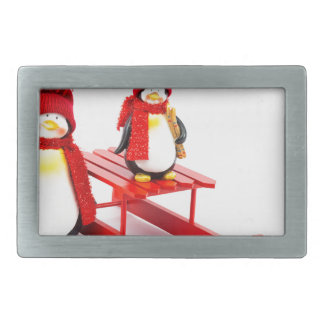 Two penguins with sleigh and christmas tree rectangular belt buckles