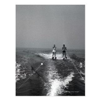 Two people waterskiing postcard
