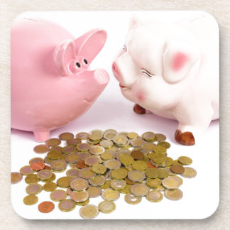 Two piggy banks with euro coins on white coasters