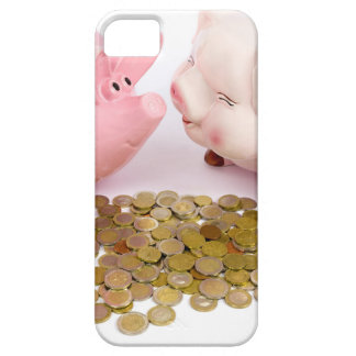 Two piggy banks with euro coins on white iPhone 5 cases